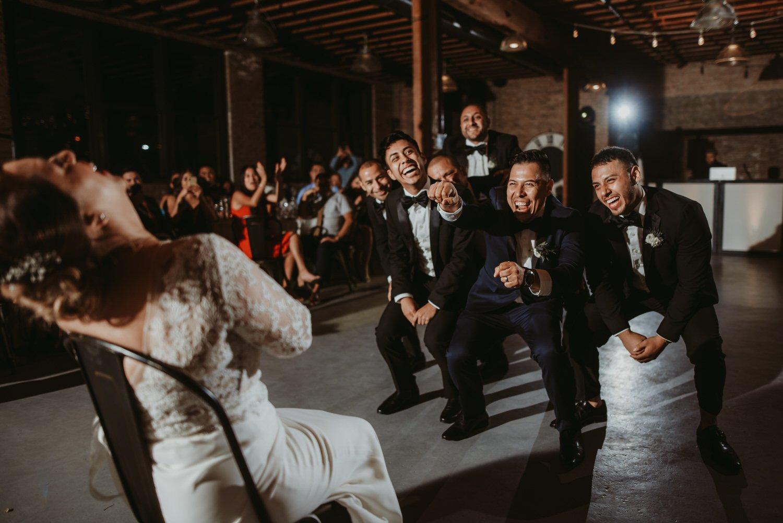 Chicago vow renewal, Groomsmen funny dance, wedding photography, The Adamkovi