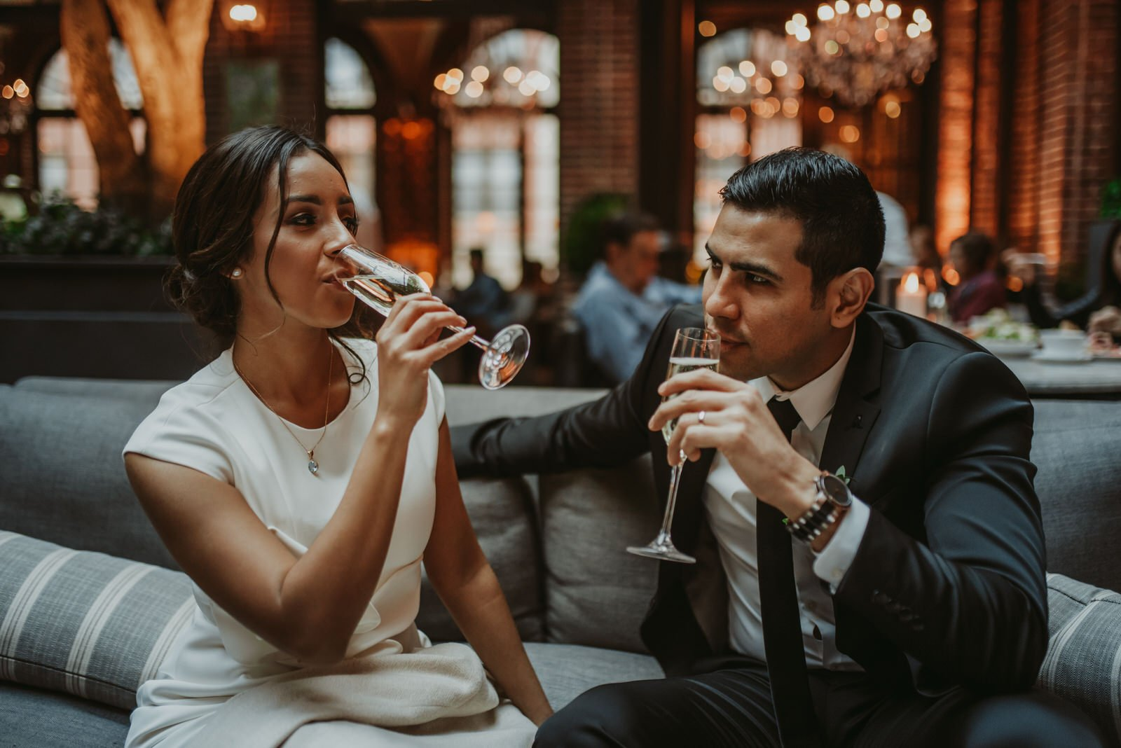 bride and groom celebrating in 3 arts cafe Chicago wedding photography