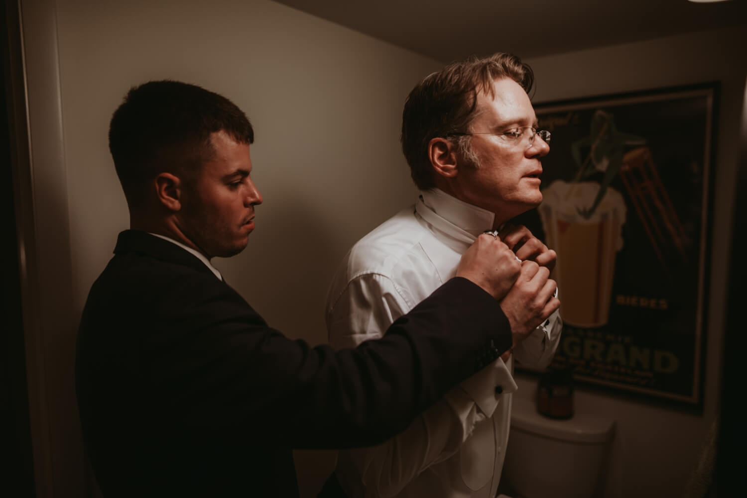 best man helping groom with a bow tie- the Adamkovi - Chicago wedding photography
