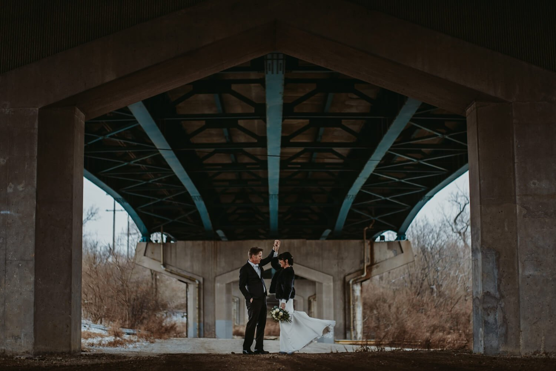 epic bride and groom photo under a bridge The Adamkovi Chicago wedding photographer