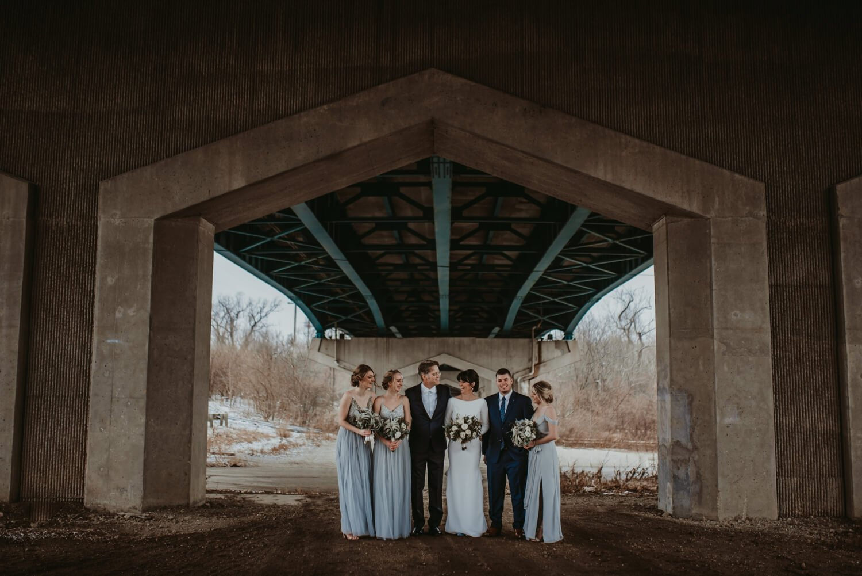 epic bridal party group photo under a bridge - The Adamkovi Chicago wedding photographer