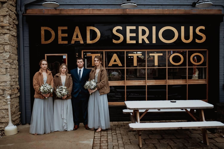 stoic funny tattoo shop bridal party photo - The Adamkovi Chicago wedding photographer