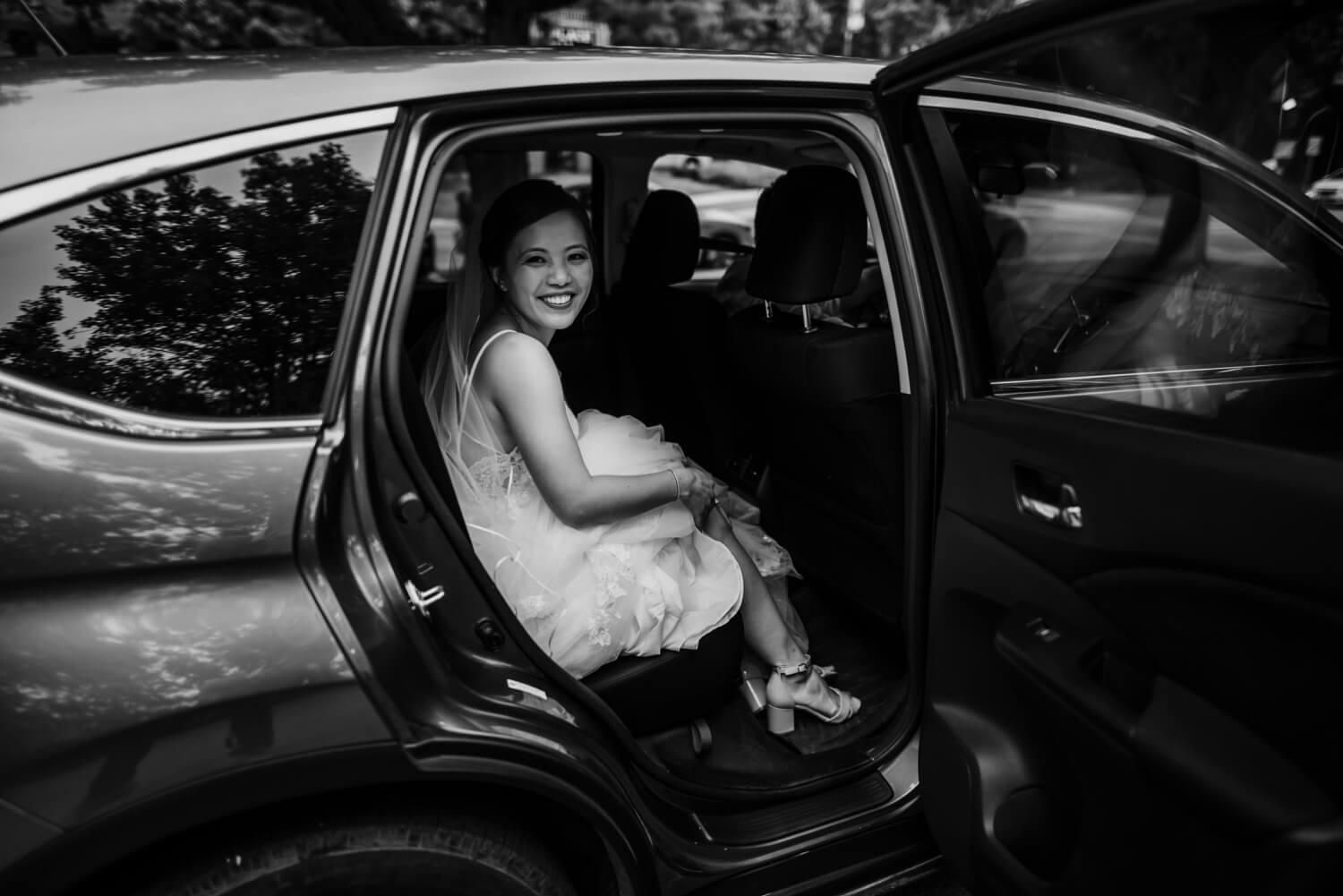 bride in a car, The Women's Club of Evanston Wedding Photographer - The Adamkovi, Chicago wedding Photographer