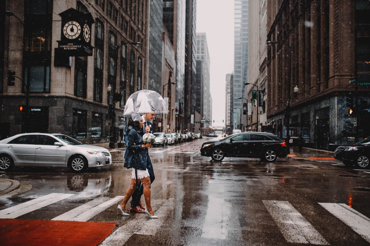 Chicago City Hall Wedding Photographer - The Adamkovi, walking on the streets with snow fall, mixed couple