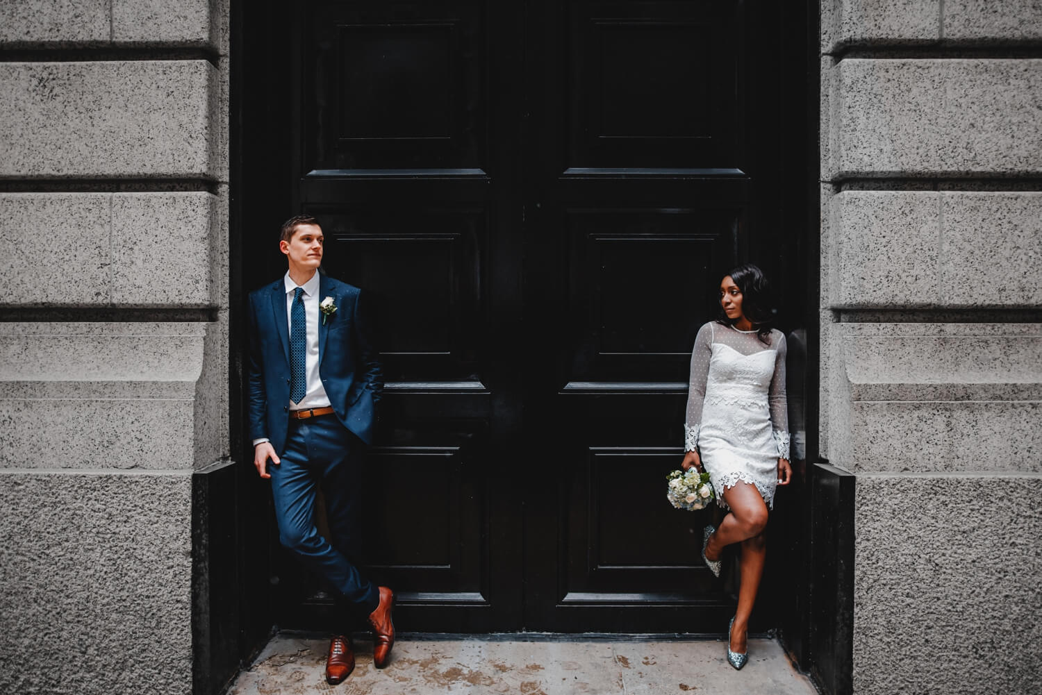Chicago City Hall Wedding Photographer - The Adamkovi, bride and groom posing as models, mixed couple