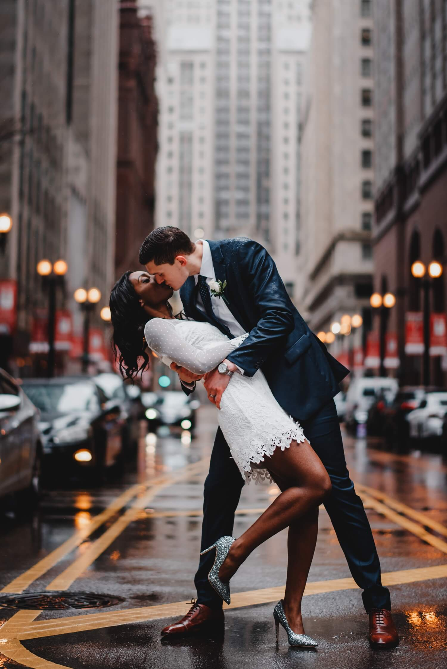 Chicago City Hall Wedding Photographer - The Adamkovi, bride and groom dip, kissing in front of the board of trade building on Lasalle ave., mixed couple