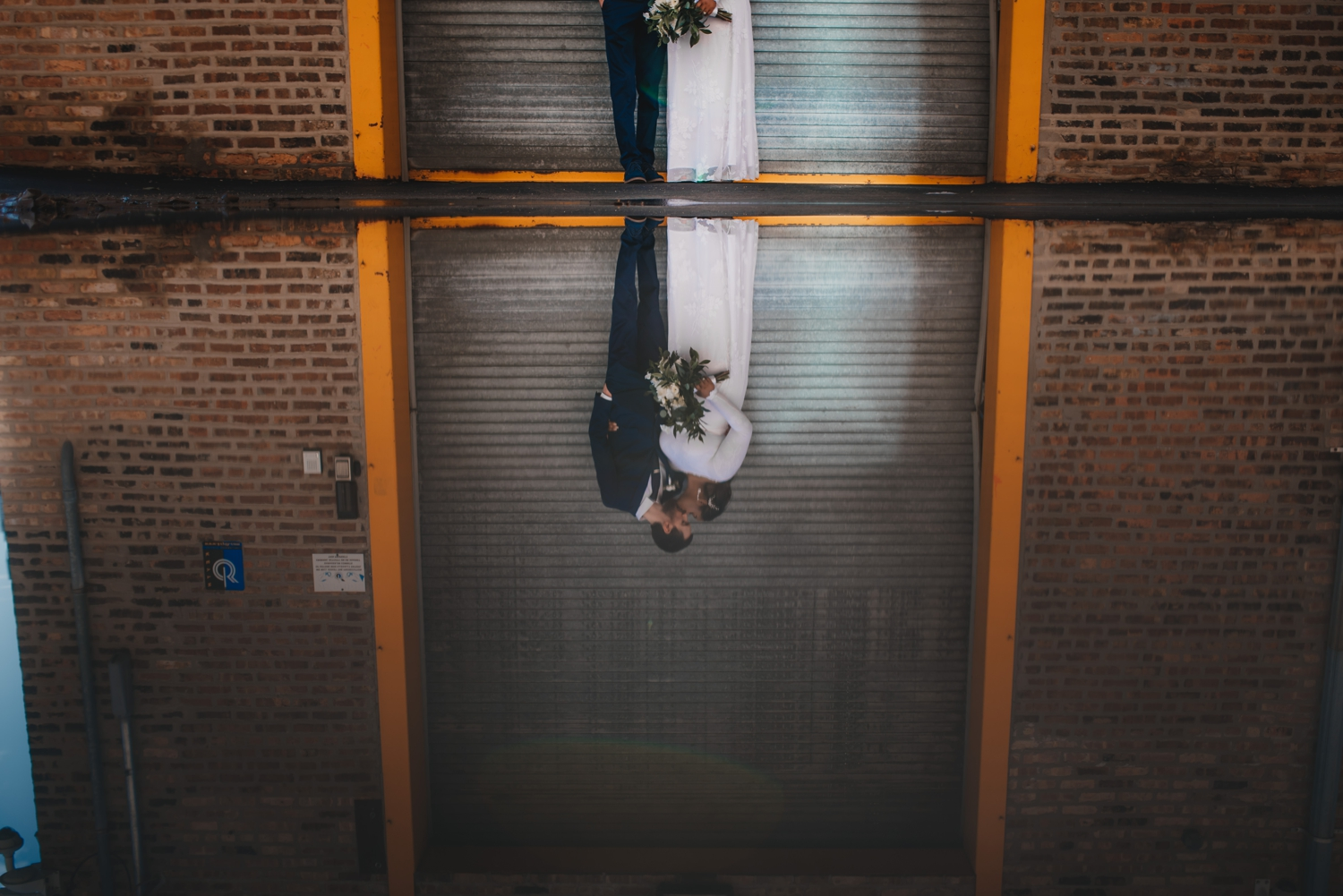 Chicago Elopement photographer - The Adamkovi, bride and groom puddle reflection grungy portrait