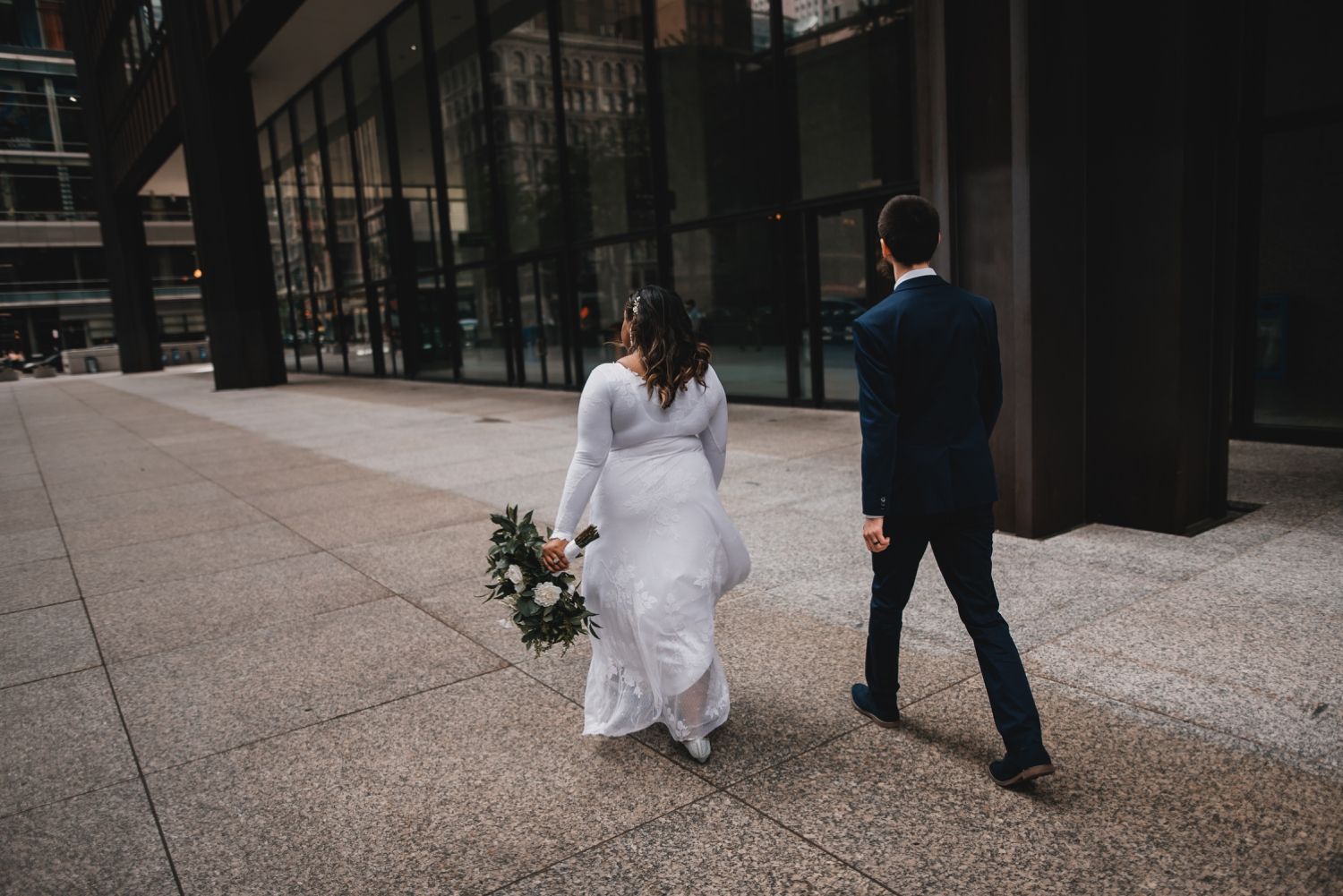 Chicago Elopement photographer - The Adamkovi, bride and groom walking in the city of Chicago