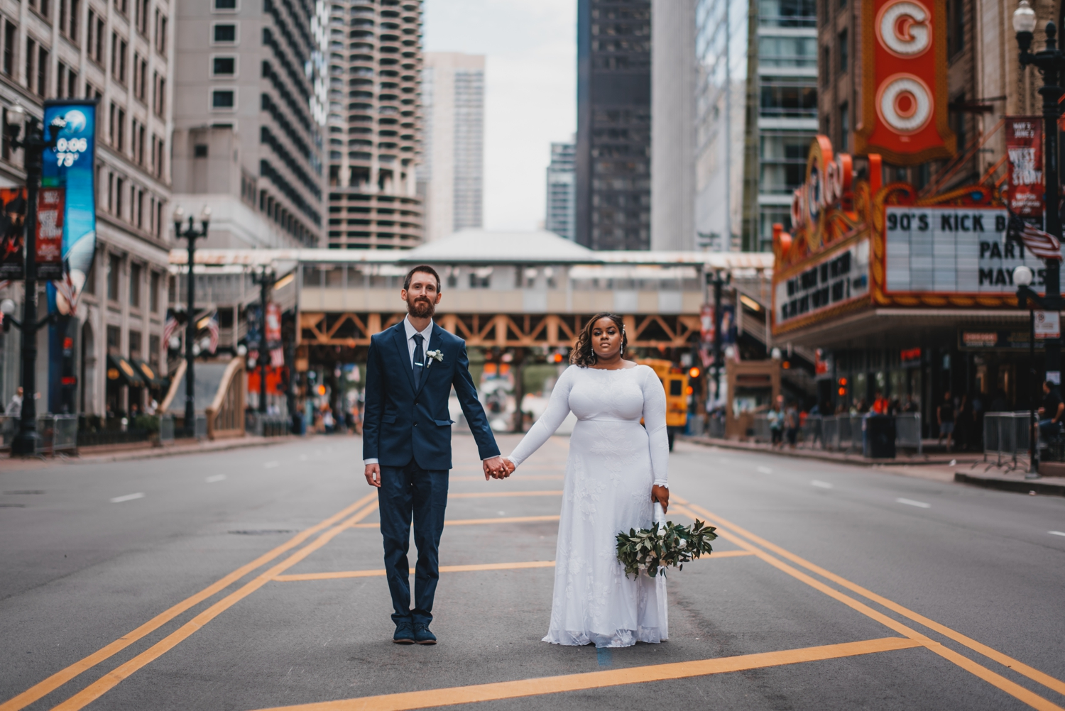 Chicago Elopement photographer - The Adamkovi, bride and groom in front of the Chicago theater