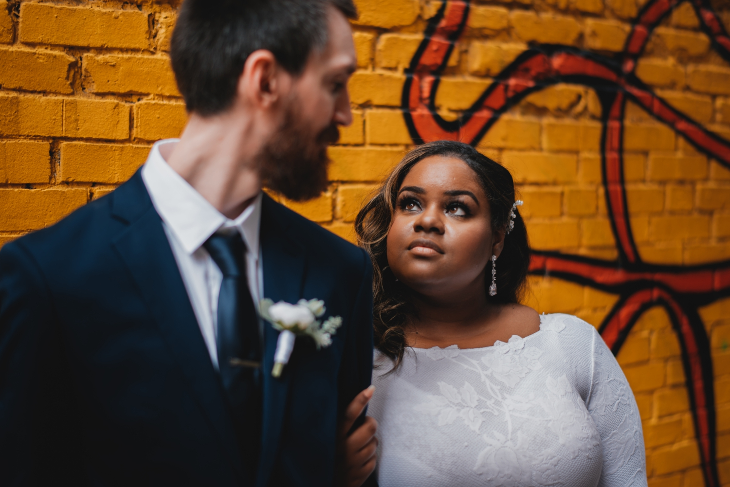 Chicago Elopement photographer - The Adamkovi, bride and groom in front of a graffiti walll