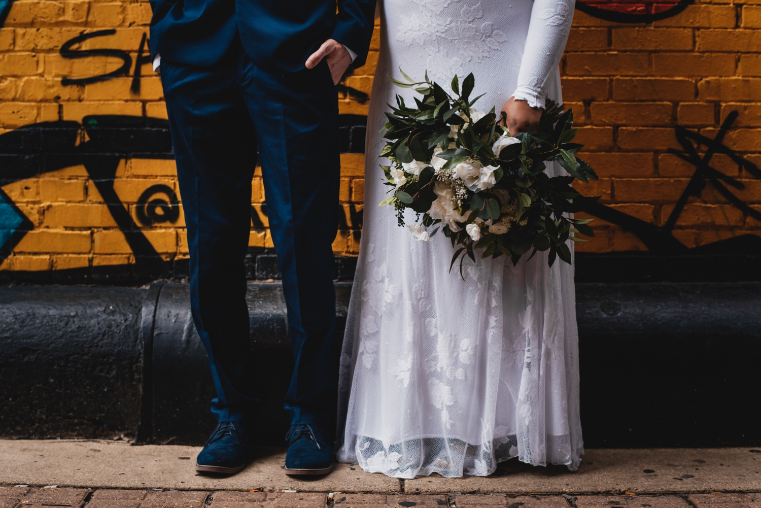 Chicago Elopement photographer - The Adamkovi, bride and groom shoes and bouquet detail in front of graffiti