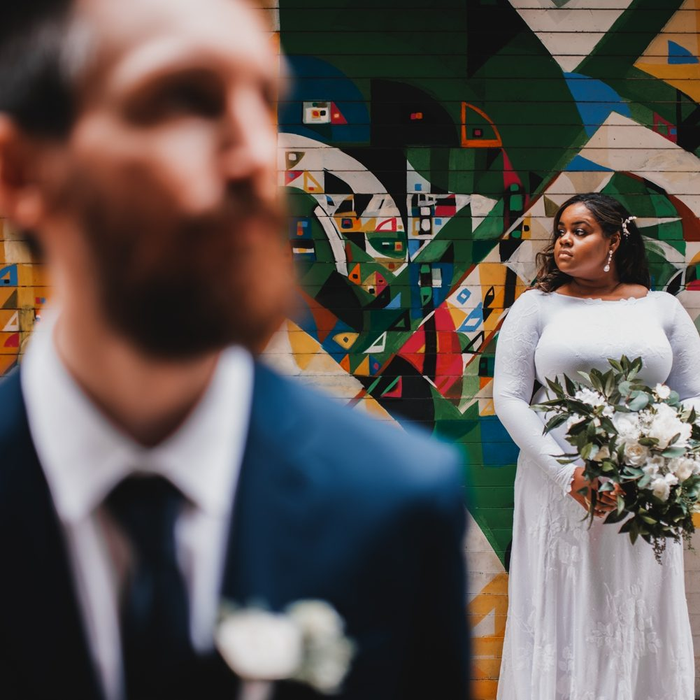 Chicago Elopement photographer - The Adamkovi, bride and groom portrait in front of street art, graffiti