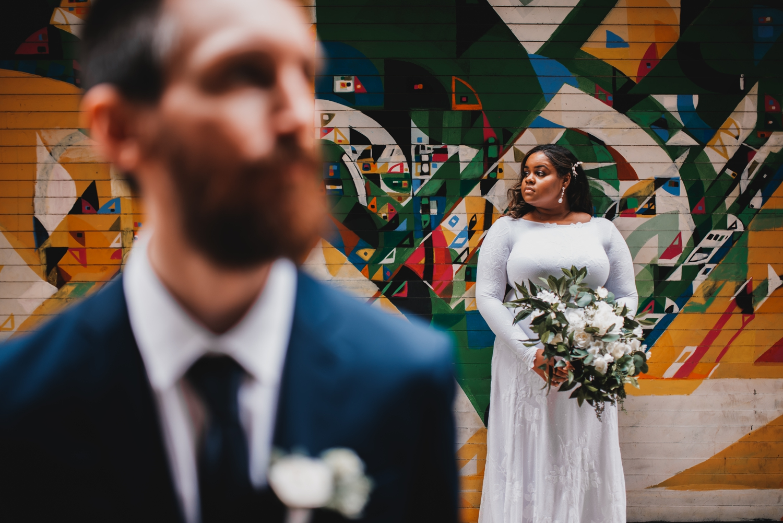 Chicago Elopement photographer - The Adamkovi, bride and groom portrait in front of street art, graffiti
