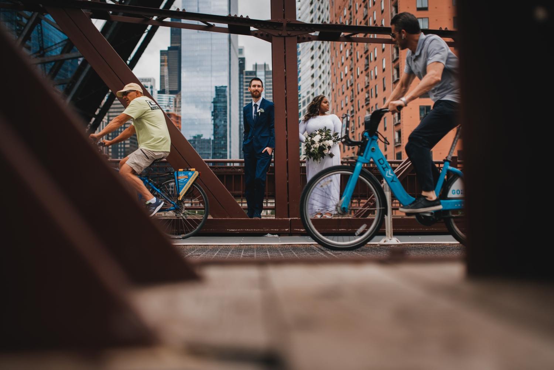 Chicago Elopement photographer - The Adamkovi, bride and groom with bikers on a kinzie street bridge