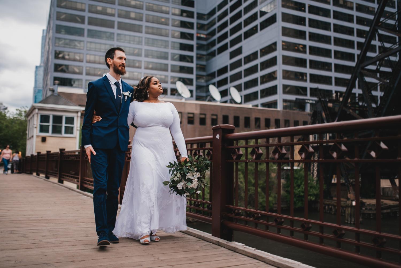 Chicago Elopement photographer - The Adamkovi, bride and groom walking on a kinzie street bridge