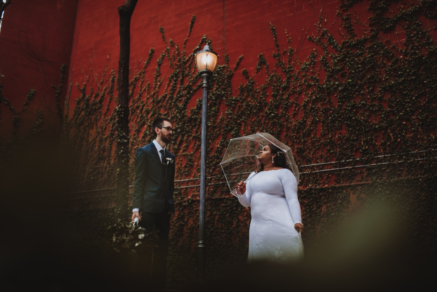 Chicago Elopement photographer - The Adamkovi, bride and groom red wall, ivy wall, umbrella photo