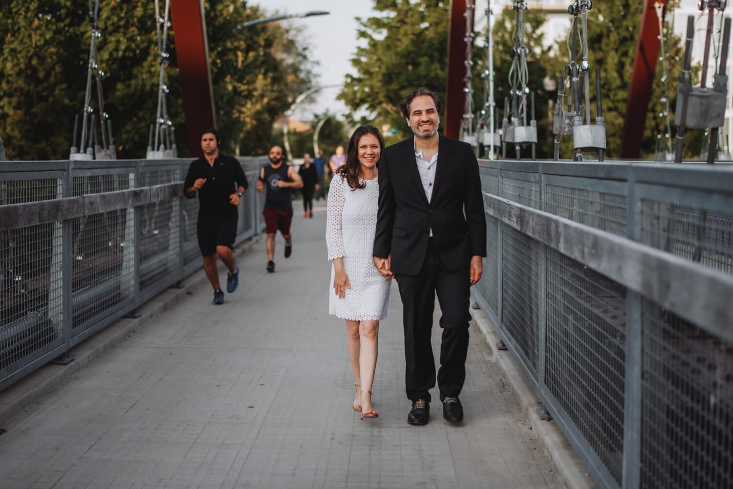 Logan Square Chicago Engagement funny photo of the bride and the groom on the 606 trail with runners in the background