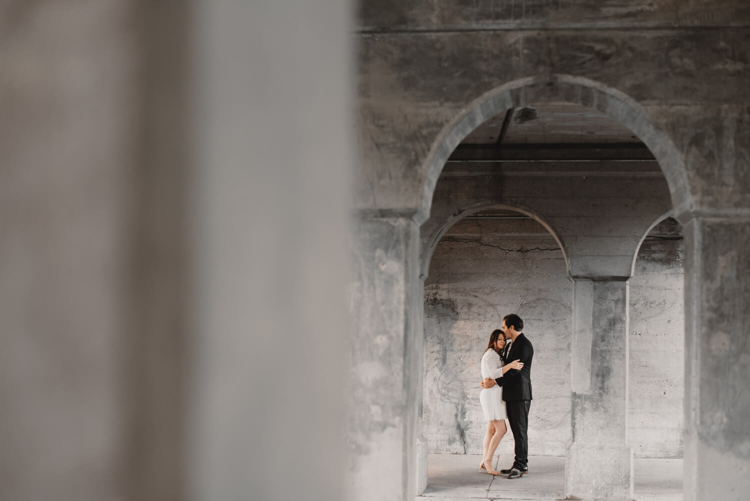 Logan Square Chicago Engagement cute photo under a bridge near 606 trail in CHicago