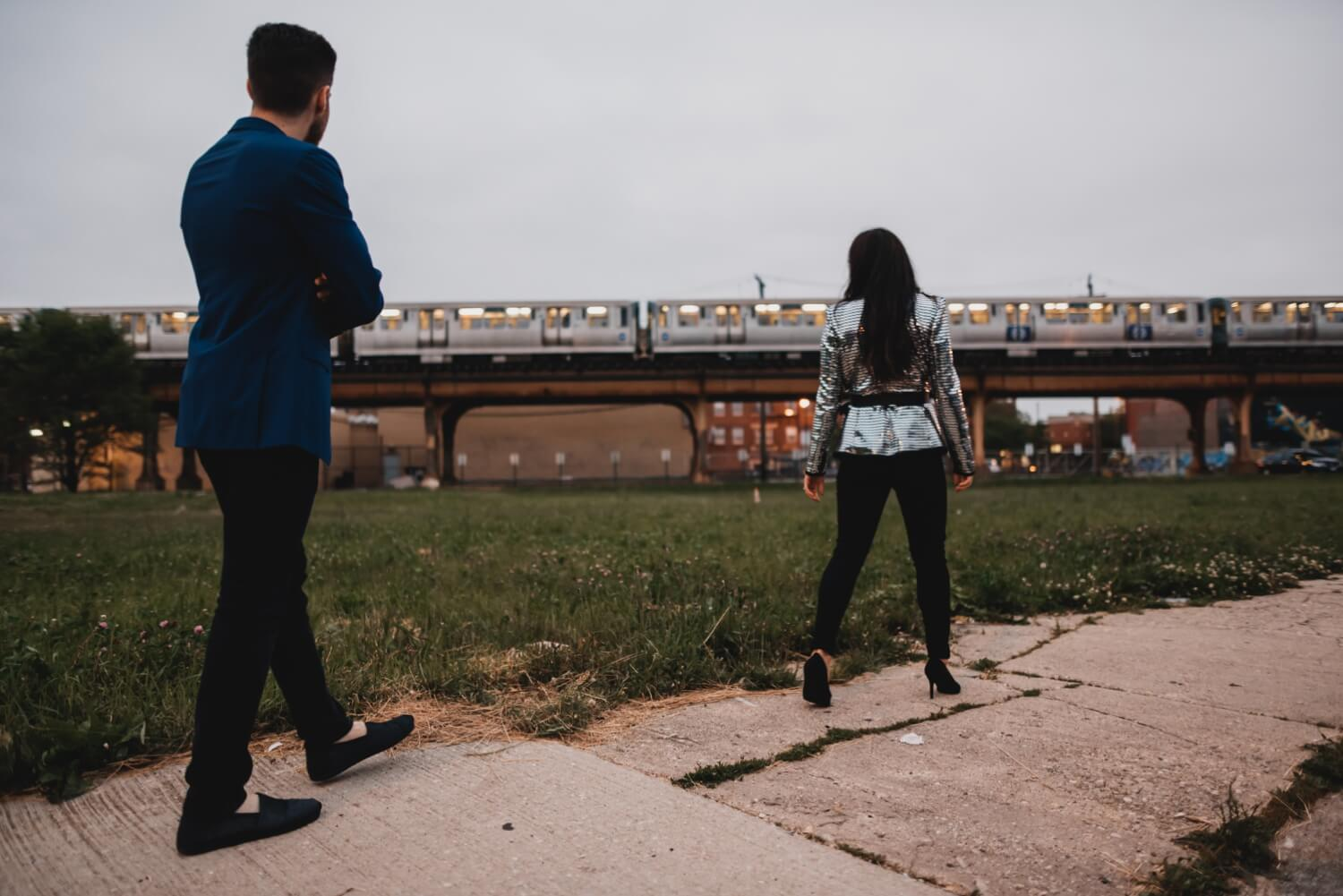 Wicker Park Engagement Photographer - The Adamkovi, with a blue line (the L) in a abackground