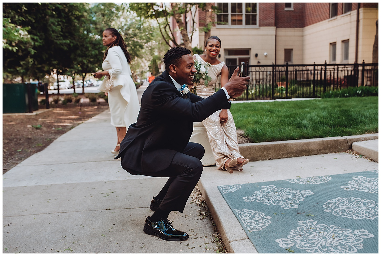 Keith House Chicago Wedding, The Adamkovi, funny groomsmen taking iPhone photo