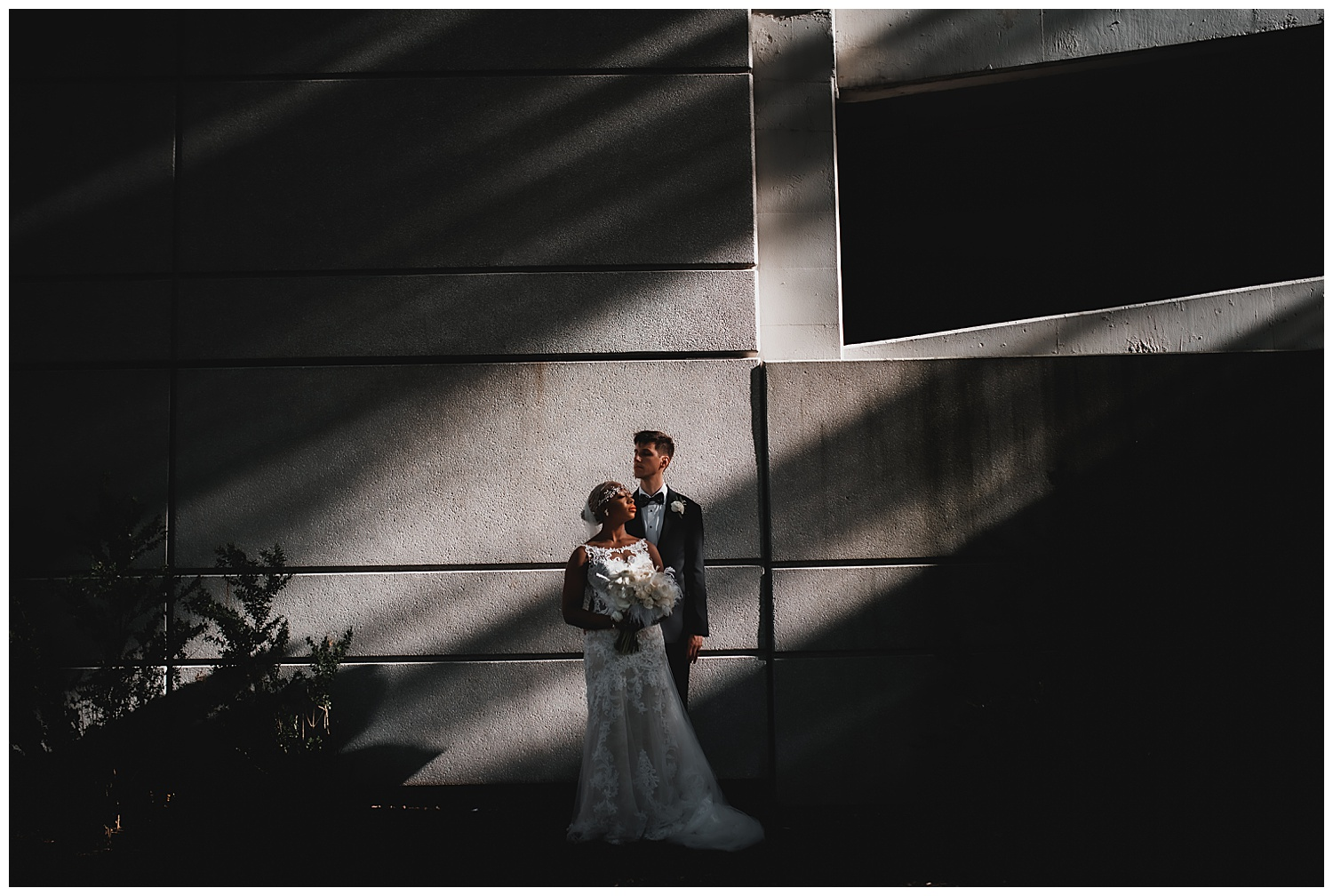 Keith House Chicago Wedding, The Adamkovi, epic bride and groom portrait in harsh light, interracial couple
