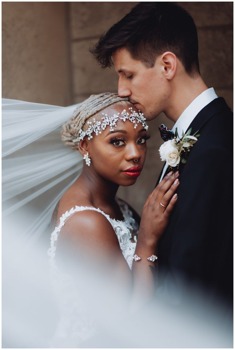 Keith House Chicago Wedding, The Adamkovi, romantic veil photo of the bride and groom, interracial couple