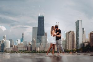 North Avenue Beach Engagement Photography Session, chicago skyline, cute couple kissing, The Adamkovi