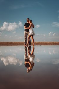 North Avenue Beach Engagement Photography Session, lake michigan, reflection, a couple in clouds, The Adamkovi