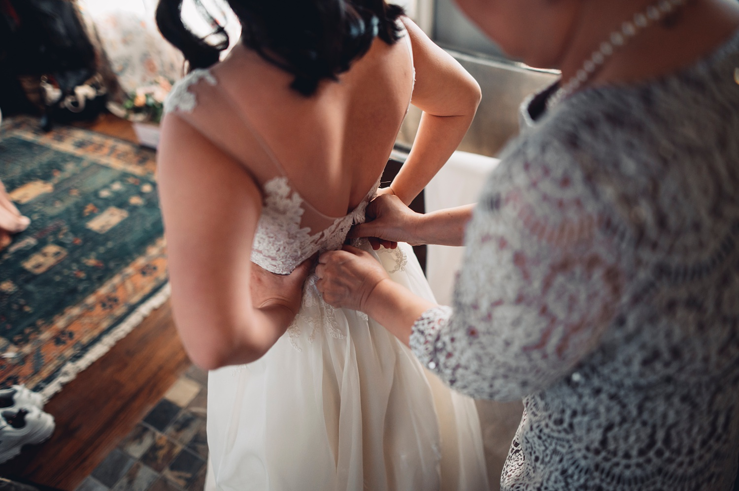 Firehouse Chicago Wedding - getting into the dress