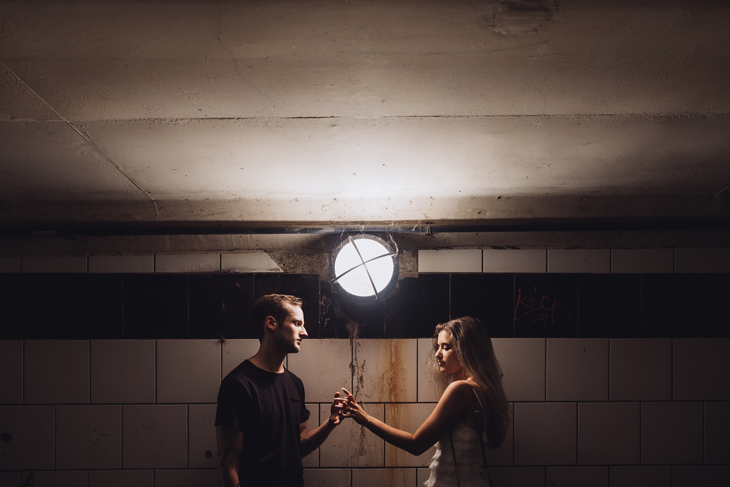 North Avenue Chicago Engagement - The Adamkovi, grungy underpass light photo