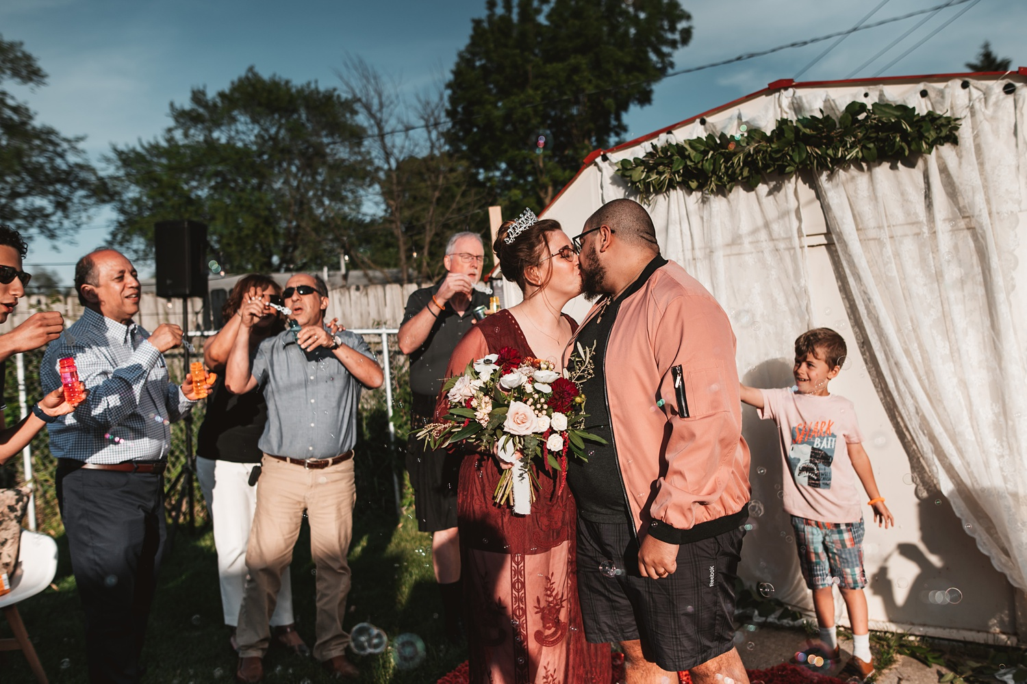 Pandemic Backyard Micro Wedding - The Adamkovi chicago ceremony first kiss bubbles
