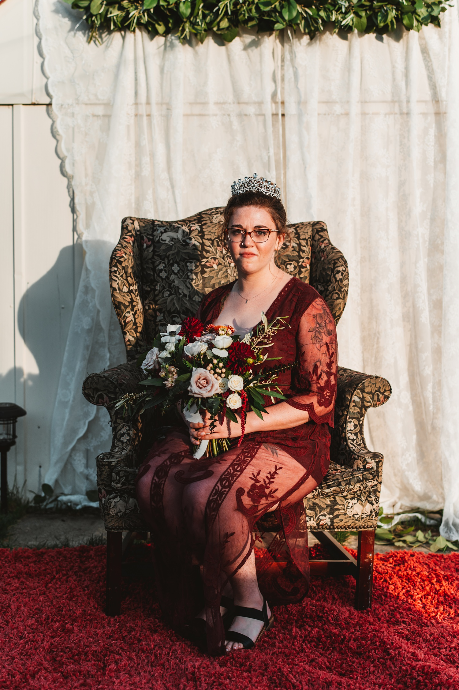 Pandemic Backyard Micro Wedding - The Adamkovi boho bride, crown, tattoos, armchair, burgundy dress