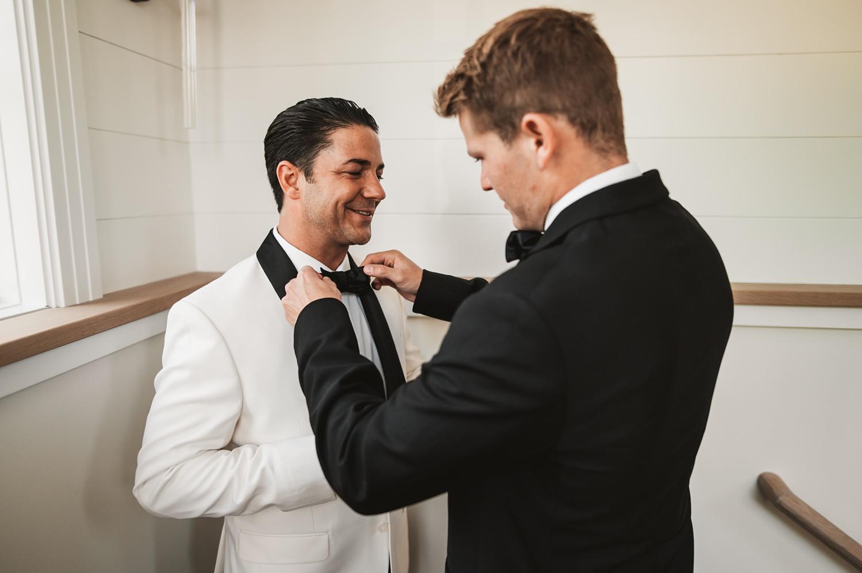 Lake Geneva Micro Wedding - The Adamkovi groom fixing his tie