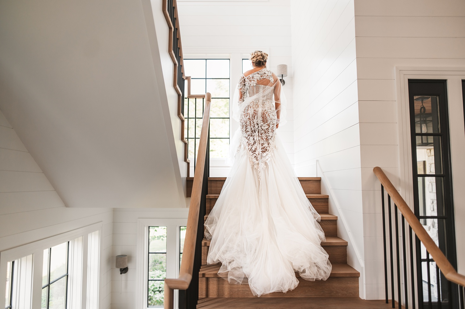 Lake Geneva Micro Wedding - The Adamkovi bride walking up the stairs in a mansion