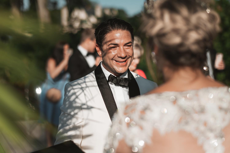Lake Geneva Micro Wedding - The Adamkovi ceremony on deck groom