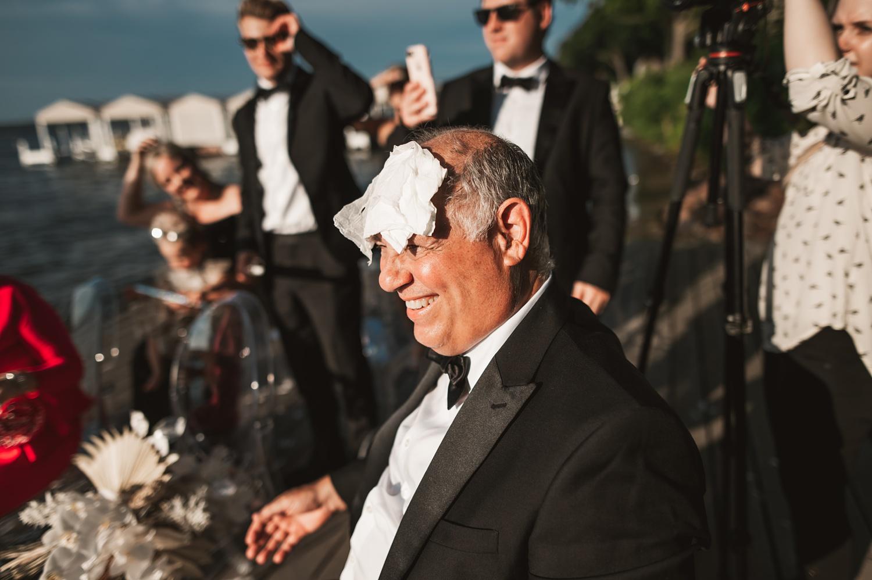 Lake Geneva Micro Wedding - The Adamkovi ceremony on deck father all funny