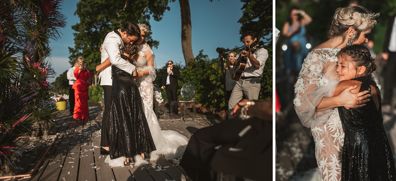 Lake Geneva Micro Wedding - The Adamkovi bride and groom hugging their new daughter and crying