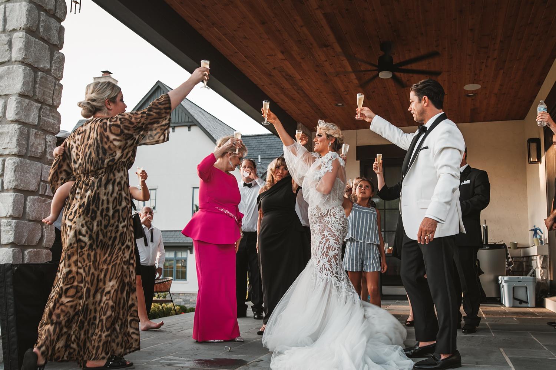 Lake Geneva Micro Wedding - The Adamkovi cheering champagne