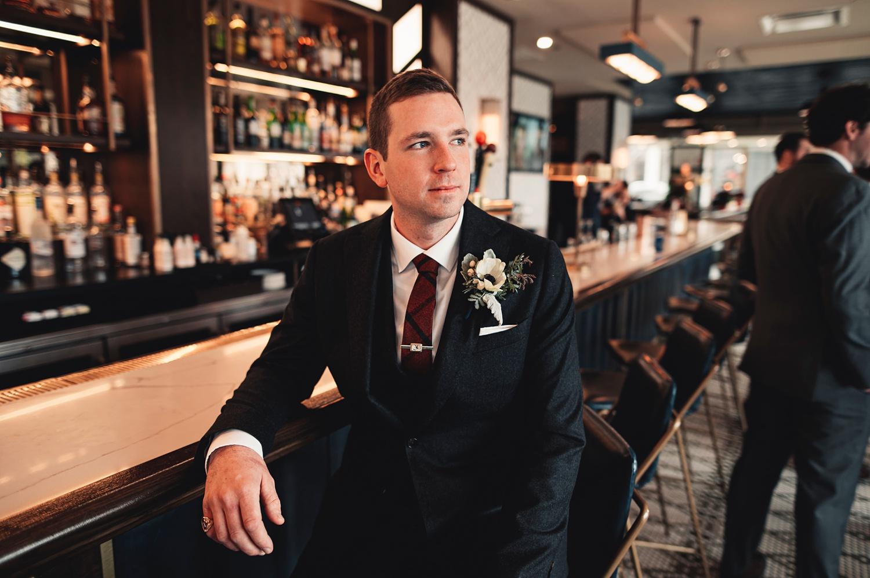 Salvatore's Chicago Wedding - The Adamkovi - groom in a bar, hotel lincoln