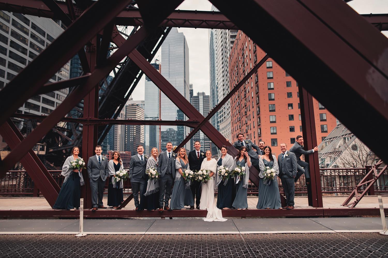 Salvatore's Chicago Wedding - The Adamkovi - bridesmaids and groomsmen on Kedzie street bridge