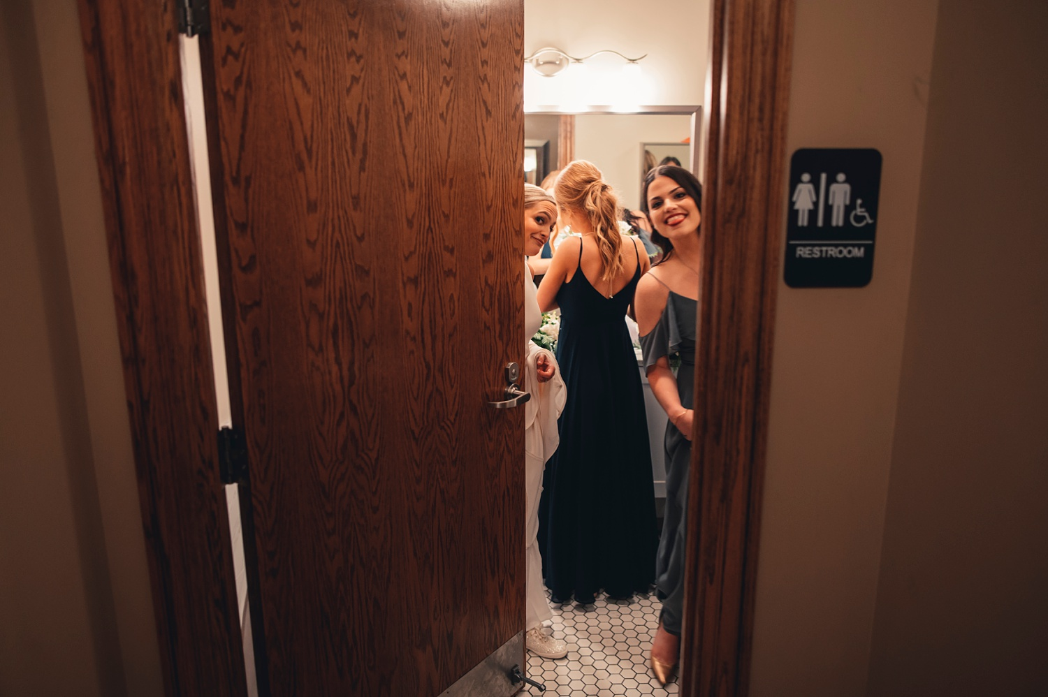 Salvatore's Chicago Wedding - St. Josaphat Catholic Church, bride and bridesmaids getting ready in a bathroom