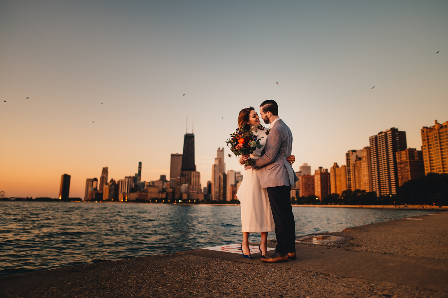 Sunrise Chicago Wedding - The Adamkovi, bride and groom creative portraits, Chicago Skyline, north avenue beach