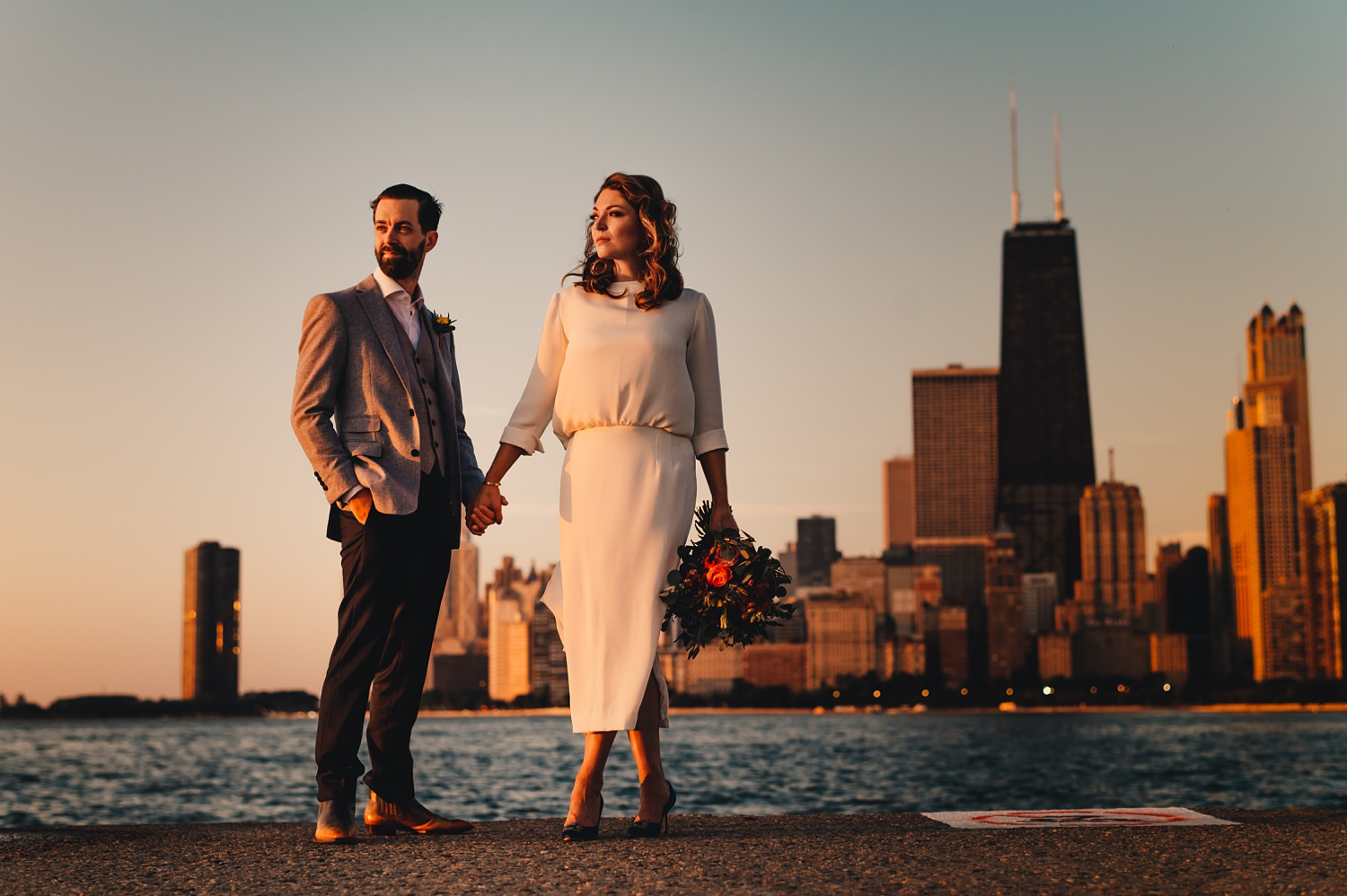 Sunrise Chicago Wedding - The Adamkovi, bride and groom creative portraits, skyline, north avenue beach