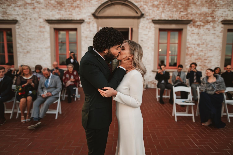 Villa Terrace Milwaukee Wedding Photography - wedding ceremony romantic, micro wedding, first kiss